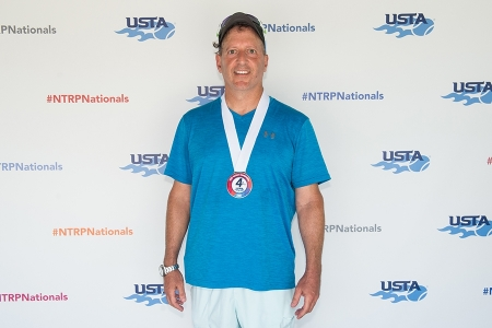 March 31, 2019 – Jerry Matteo with his medal after winning fourth place during the USTA NTRP Nationals 18 & Over Men's & Women's 3.0, 3.5,4.0, 4.5, 5.0 Singles at Academia Sanchez-Casal Florida in Naples, Florida.