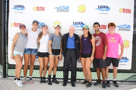 Bobby poses with players at the 2019 USTA Florida Bobby Curtis Junior 16s/18s Sectionals Doubles Championships