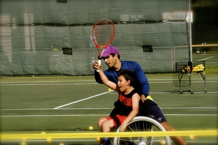 Fernandez coaching a wheelchair player