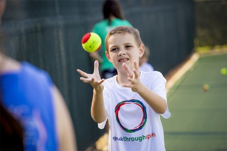 Speak Through Sports tennis clinic