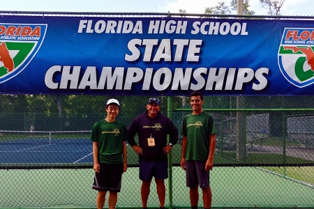 Manuel Rosales at the Florida High School State Championships with two of his students