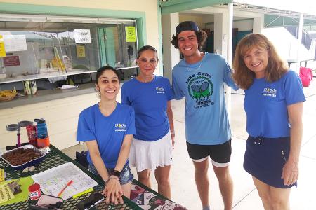 (L-R) Milena's daughter Jen, Milena, Sami Ozzor, and Janie volunteering at an ITF International Juniors tournament