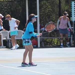 Miriam competing in the Women's Blast Off Doubles Tournament at the Racquet Club of Cocoa Beach