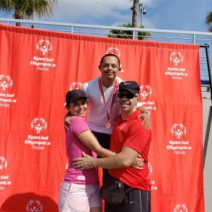 Santiago with his mother and stepfather at the 2019 Special Olympic State Games