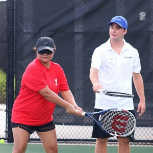 Travis Tressler taking part in a Wounded Warriors tennis event