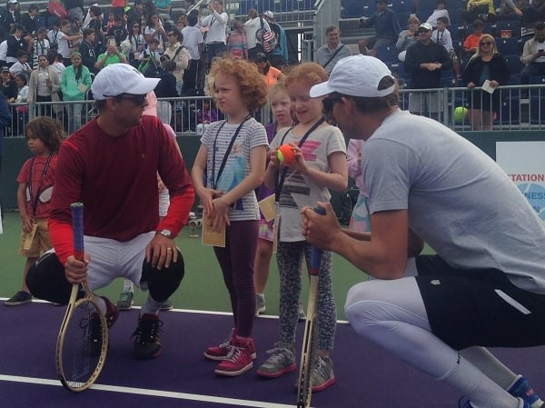 The Bryan brothers speak to another pair of twins at the USTA Florida Kids Day at the Miami Open